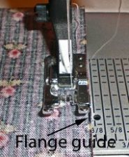 Presser foot with a guide on the right-hand side
