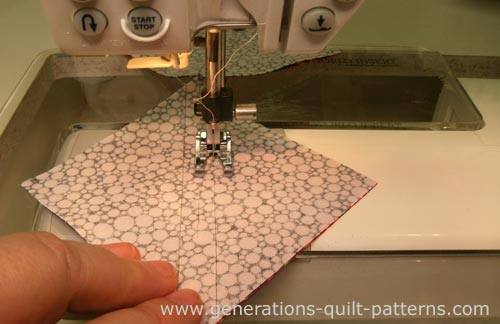 Stitch on the drawn lines when you use a Quick Quarter Ruler to mark.