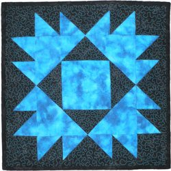 Beginning machine quilting includes both stitch in the ditch and free motion quilting stitches