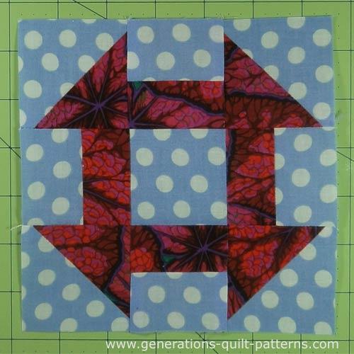 Finished Churn Dash quilt block