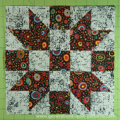 The finished Churn Dasher quilt block