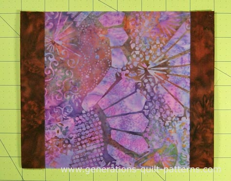 Stitch a #2 patch to the left and right sides of the center square