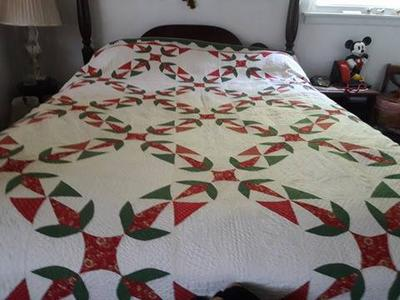 Do you know the name of this applique quilt pattern