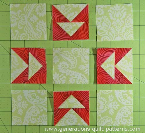 Lay out the solid squares and Flying Geese pairs in rows