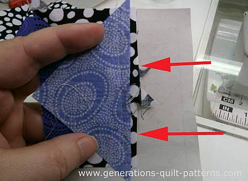 Trim away the excess past the seam allowance with a scissor or rotary cutter