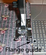Quarter inch presser foot with a guide