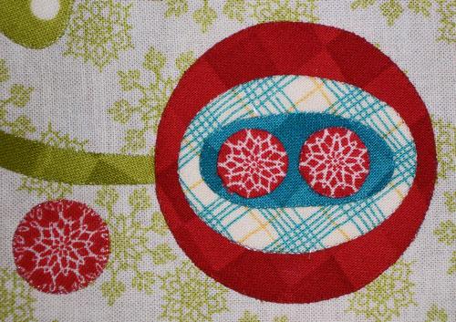 Close-up of the fussy cut circles