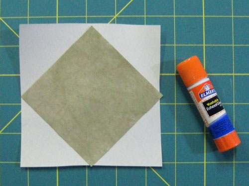 Glue the first patch onto the backside of the square in a square block pattern