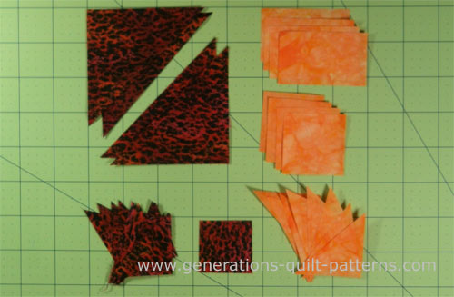 The cut patches for a Goose Tracks quilt block
