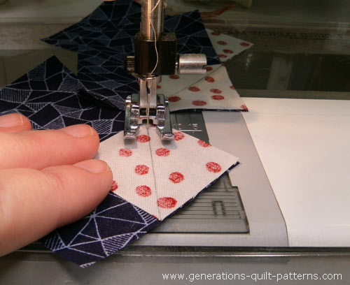 Stitching connector corners with an open to applique foot.