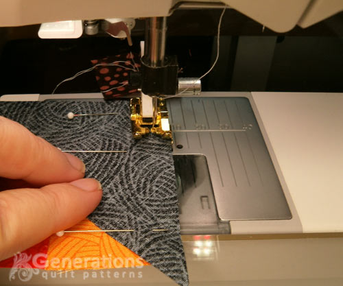 Stitch a #2 triangle to the side of a four-patch unit