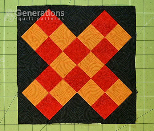 A finished Grandmother's Cross quilt block