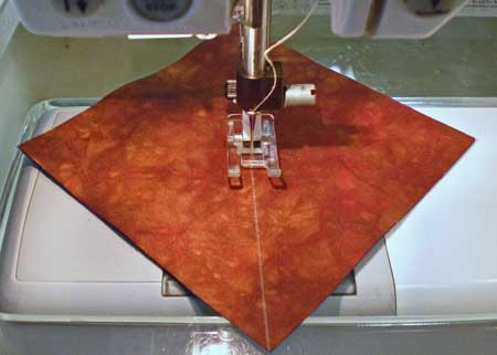 Sew the half square triangle diagonally from corner to corner