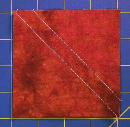 Press the half square triangle flat