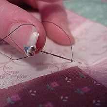 Hand quilting thimble search