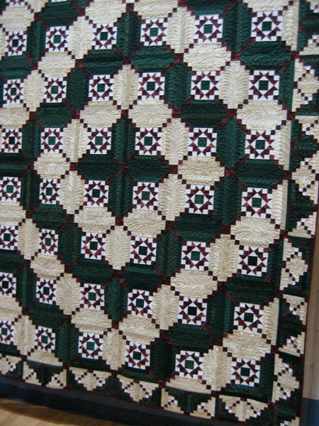 Log cabin quilt squares with a pieced center square