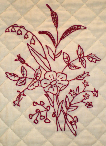Hand embroidery with machine quilted grid quilting