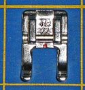An open toe applique presser foot