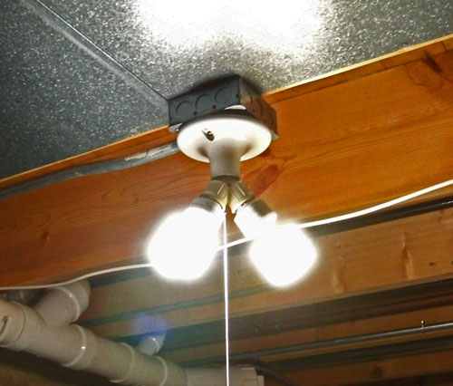 Overhead light for cutting table