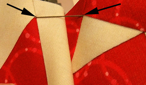 Insert the pin at the point on the second patch
