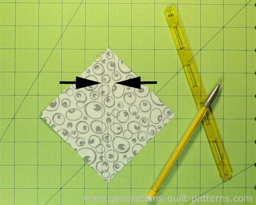 A half square triangle unit marked and ready to sew.