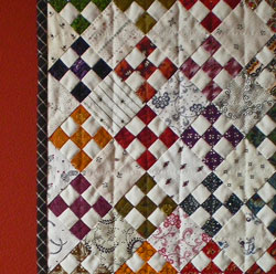 Quilt binding with a plaid fabric