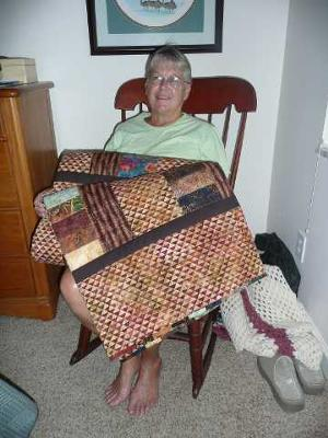 Elaine with Phil's quilt<br /><br />Click on any thumbnail below for a larger image<br /><br />