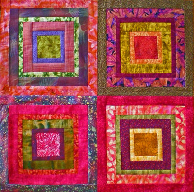 A set of 'Court House Steps' quilt blocks