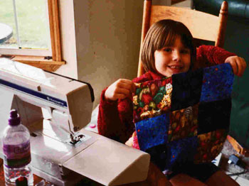 Reilly finishes her first quilt block