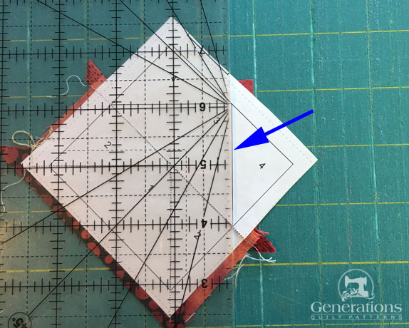 Fold the paper back on itself at the seam line