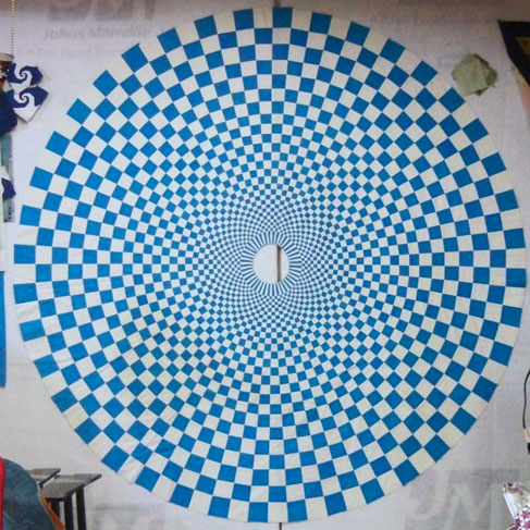 Turquoise and white quilt is pieced with white thread