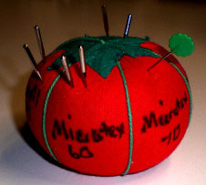 Tomato pin cushion for storing used sewing machine needles