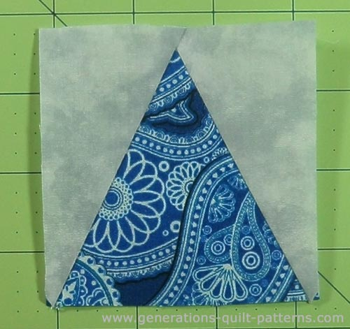The finished triangle in a square