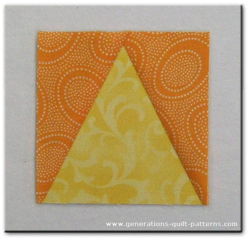 A finished Triangle in a Square quilt block