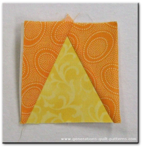 An untrimmed Triangle in a Square quilt block