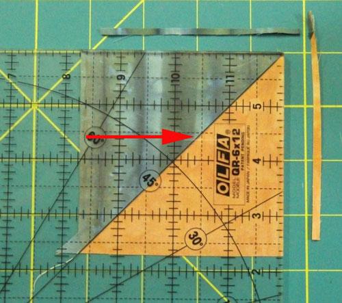 Trim the half square triangle unit to size