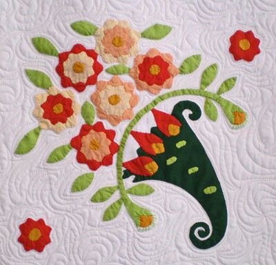 The applique flowers come forward visually because the batting can puff up behind them to create dimension.