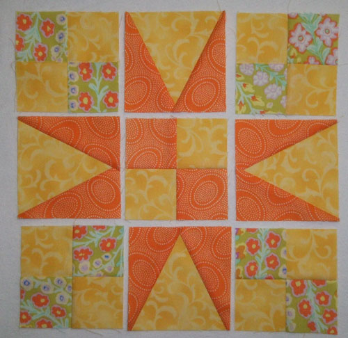 54-40 or Fight quilt block units are laid out in rows
