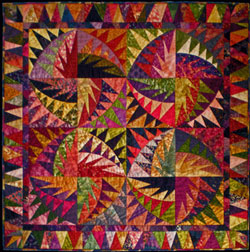 All the quilting on this scrappy quilt is in the ditch