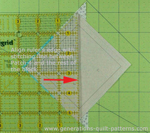 Align the edge of the ruler with the seam line