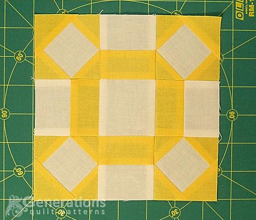 A finished Broken Wheel quilt block