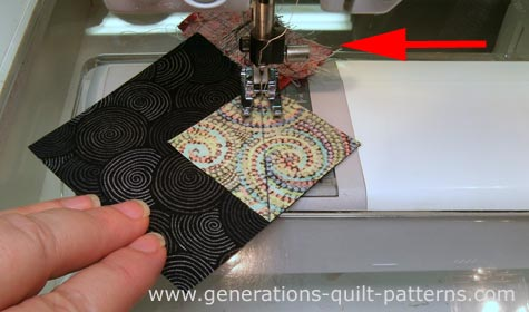Stitch on the line. I'm using my open toe applique foot for this stitching.