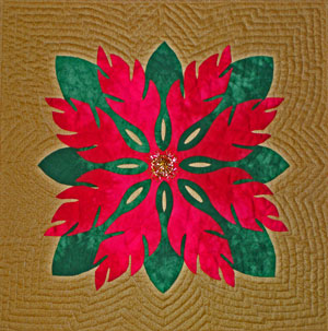 This is an example of echoing around an appliqued shape, in this case, a Hawaiian<br>quilt design.