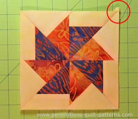 Finished Flying Kite quilt block with one dog ear left to trim
