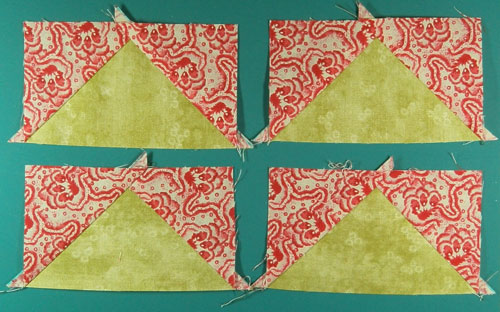 Four stitched no waster flying geese quilt blocks