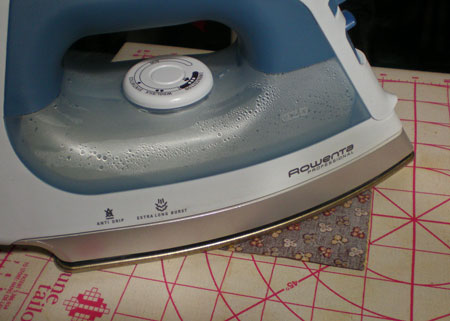 Press the HST flat to set the seam