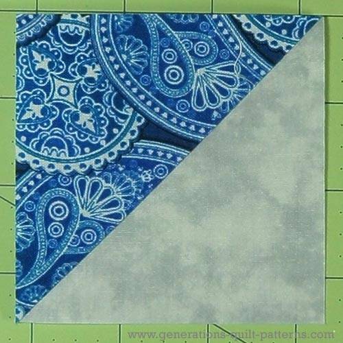 The finished half square triangle ready for use in your quilt