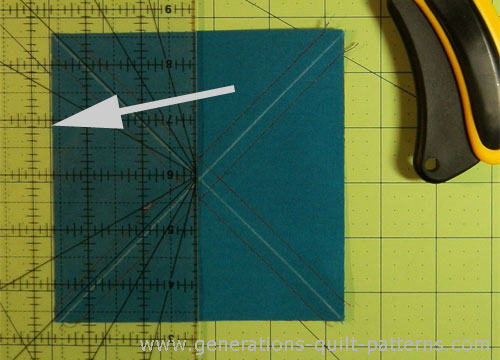 Align the 2-5/8 inch mark of the ruler along the edge of the square