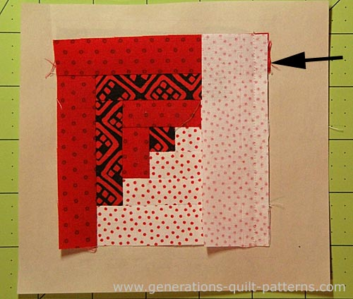 Trim away any excess dark fabric that shows past the seam allowance to prevent it from shadowing through