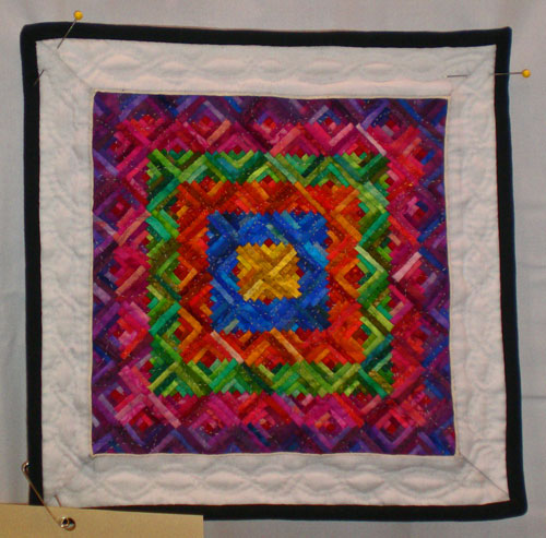 Log cabin quilt squares with tiny logs